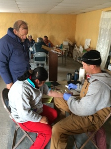 Cody Wells drawing blood from a patent in Las Norias for typhoid testing.